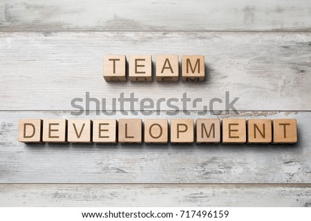team development text on wooden cubes on wooden background