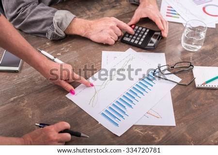 Team discussing about financial charts