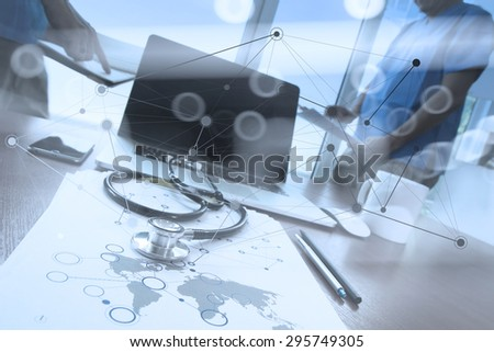 team doctor working with laptop computer in medical workspace office and medical network media diagram as concept with network diagram - stock photo