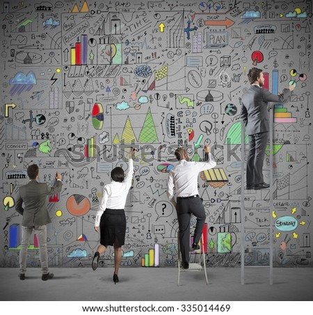 Team draws business analysis on the wall - stock photo
