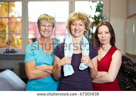 Team group of three females in a gym - stock photo