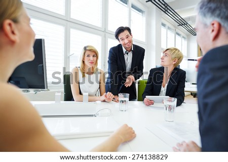 Team having discussion in business meeting in the office - stock photo