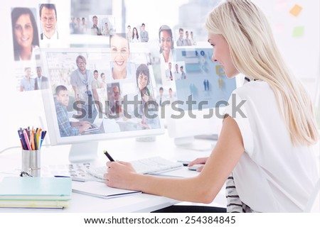 Team having meeting and smiling at camera against business people - stock photo