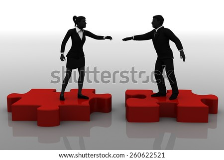 Team Hiring on a Jigsaw puzzle. A team of two executives being formed on top of pieces of a jigsaw puzzle.  - stock photo