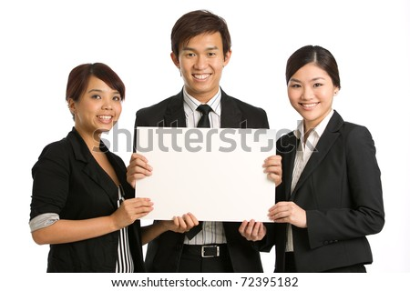 Team holding a blank sign with room for you to add your own message - stock photo