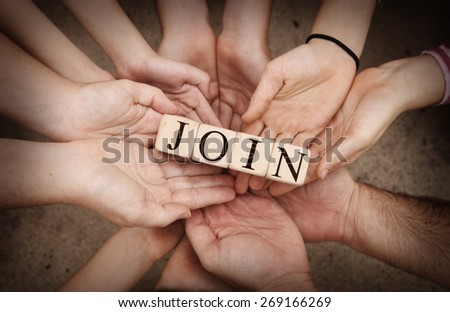 Team Holding Building Blocks spelling out JOIN - stock photo