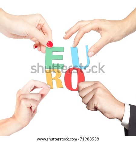 Team holding together letters forming the word euro (finance, banking, investment, strategy, cooperation, teamwork concept and more) - stock photo