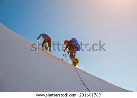 Team in hike high in the mountain - stock photo