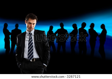 Team Leader with silhouettes behind him - check my gallery for more business photos - stock photo