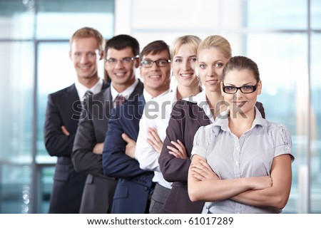 Team members standing on the growth in office - stock photo
