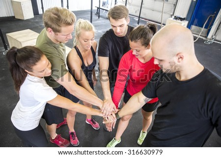 Team motivation before workout at the gym - stock photo
