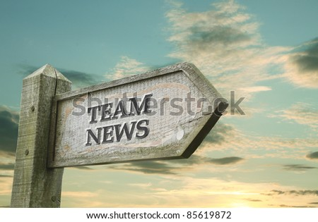 Team News Wooden Sign - stock photo