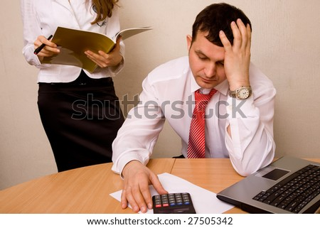 Team of accountants, having hard time calculating losses - stock photo