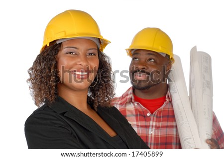 Team of architect and builder in hardhats - stock photo