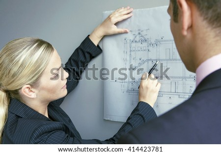 Team of architects people checking design documents and business workflow - stock photo
