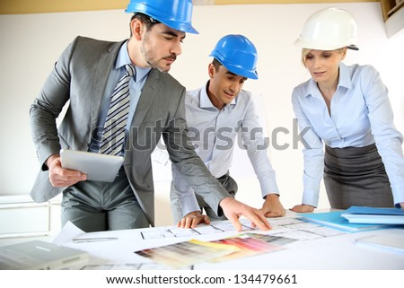 Team of architects presenting construction project - stock photo
