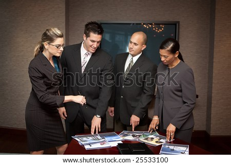 Team of business people discussing a project - stock photo
