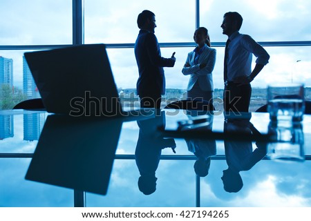 Team of business people discussing plans in modern office