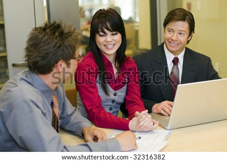 Team of business people having a meeting - stock photo