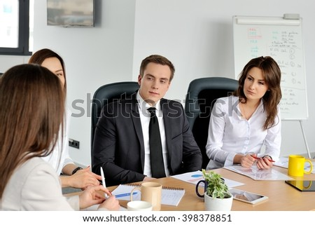 Team of business people having a meeting in an office. - stock photo