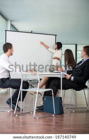 Team of business people having a work meeting in modern office