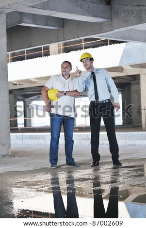 Team of business people in group, architect and engeneer  on construciton site check documents and business workflow on new building - stock photo
