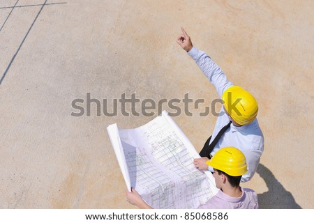 Team of business people in group, architect and engineer  on construction site check documents and business workflow on new building - stock photo