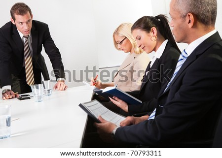 Team of business people taking notes - stock photo