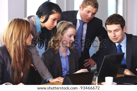 Team of 5 business people working on laptop during their meeting - stock photo