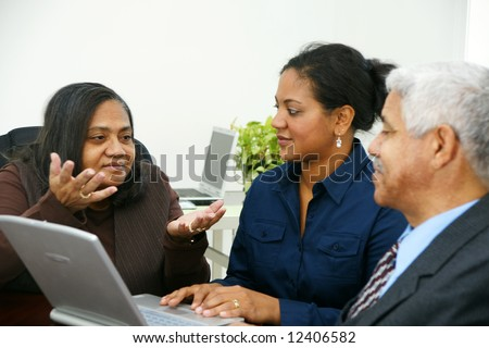 Team of business people working together in an office