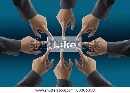 team of businessman push on like button for teamwork concept - stock photo