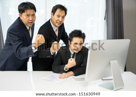 Team of businessmen analysis their business with computer desktop - stock photo