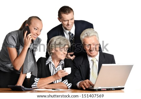 team of businessmen works with the computer - stock photo