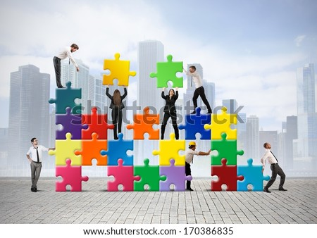 Team of businesspeople build a new company - stock photo