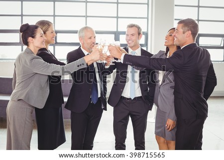 Team of businesspeople toasting champagne in the office - stock photo