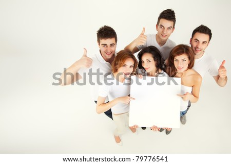 team of casual young people holing blank banner - stock photo