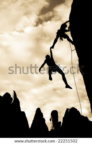 Team of climbers in trouble clinging to a cliff for dear life in The Sierra Nevada Mountains, California. - stock photo