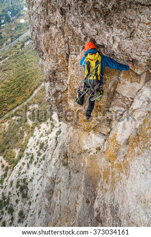 Team of climbers on the rock. - stock photo