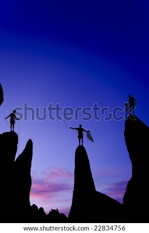 Team of climbers reaching the summit of a group of rock pinnacles in The Sierra Nevada Mountains, California. - stock photo