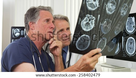 Team of competent doctors working in the office - stock photo