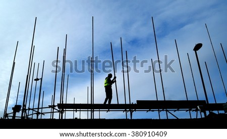 Team of construction workers taking off the roof from building - stock photo