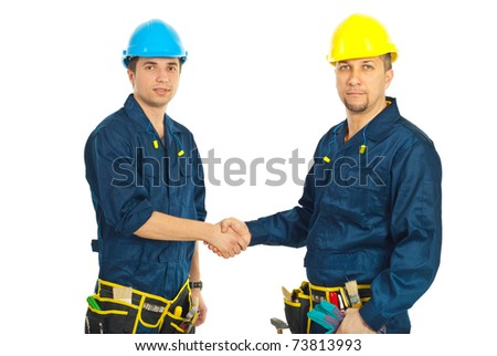 Team of constructor workers giving handshake isolated on white background - stock photo