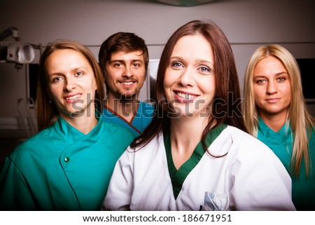 Team of dentist at dental clinic group portrait - stock photo
