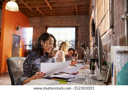 Team Of Designers Working At Desks In Modern Office - stock photo