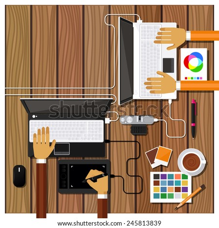 Team of designers working together on a computer. Creative team. flat design style - stock photo
