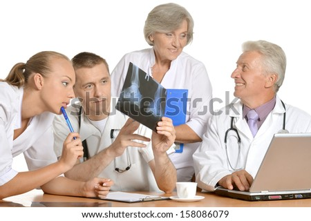 team of doctors are considering an X-ray - stock photo