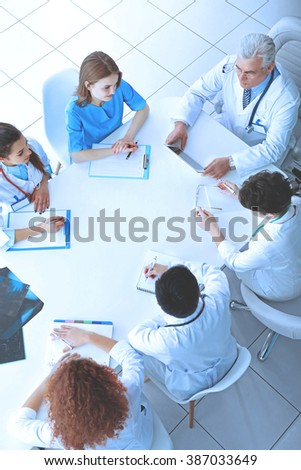Team of doctors at working place indoors - stock photo