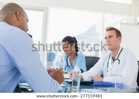 Team of doctors having a meeting in the meeting room