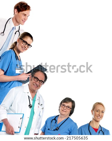 Team of doctors posing in L shape - stock photo