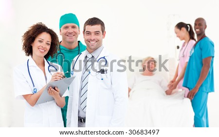 Team of Doctors with a patient - stock photo